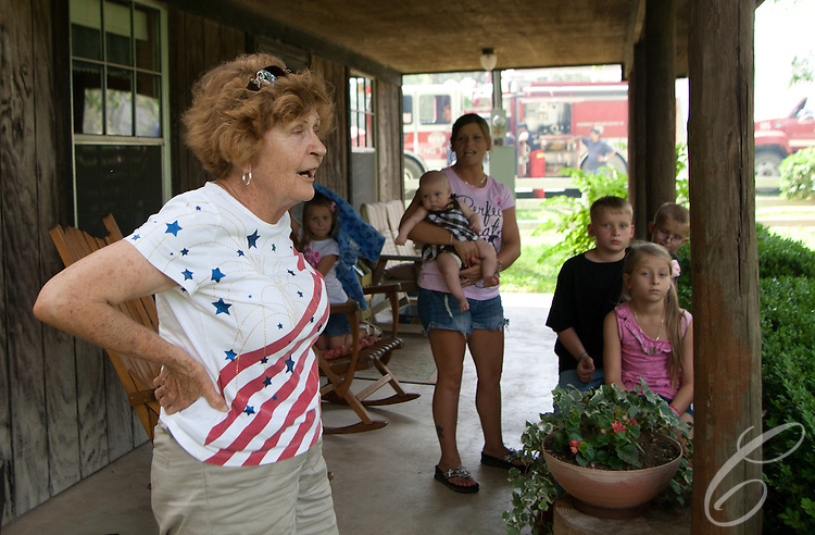 Dee Laitkep and her family watch as fire crews draw water from their pond in Grimes County to fight the Dyer Mill fire on June 21, 2011.  Laitkep and her husband Ed made the water from their well-fed pond available as fire crews battle the wildfire, which has already claimed more than 30 homes and numerous out-buildings, for a third day.