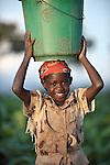 Sibongile Theghe carries water home in Ekwendeni, Malawi.