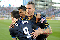 Sebastien Le Toux (9) of the Philadelphia Union celebrates scoring the first goal of the game with Danny Califf (4) and Michael Orozco (16) in the fourth minute during a Major League Soccer (MLS) match against D. C. United at Lincoln Financial Field in Philadelphia, PA, on April 10, 2010.