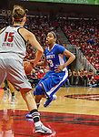 Sophomore guard Bria Goss drives into the paint as Louisville's Freshman guard Megan Deines sets up her defensive position. in Louisville, Ky., on Sunday, December, 2, 2012. Photo by James Holt | Staff