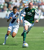CARSON, CA - June 17, 2012: LA Galaxy defender Sean Franklin (5) and Portland Timbers forward Kris Boyd (9) during the LA Galaxy vs Portland Timbers match at the Home Depot Center in Carson, California. Final score LA Galaxy 1, Portland Timbers 0.