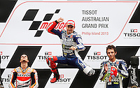 Yamaha MotoGP rider Jorge Lorenzo (center) of Spain celebrates in the podium after winning the 2013 Australian Motorcycle Grand Prix with Honda MotoGP rider Dani Pedrosa (left) of Spain and Yamaha MotoGP rider Valentino Rossi of Italy in Phillip Island, Oct 20, 2013. Photo by Daniel Munoz/VIEWpress IMAGE RESTRICTED TO EDITORIAL USE ONLY- STRICTLY NO COMMERCIAL USE.