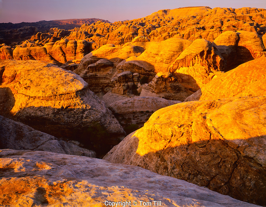 Nubian Sandstone Domes at Sunrise, View towards the high place, Ancient Nabataean City Site, Petra National Park, Jordan