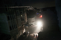 "In this Sunday, Aug. 17, 2014 photo, an overview of a street at night in Shayaja neighborhood of Gaza City during the five days truce of the ongoing ""Protective Edge"" Israeli military operation in Gaza Strip. (Photo/Narciso Contreras)"