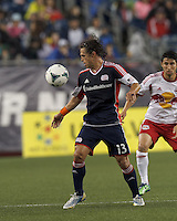 New England Revolution midfielder Ryan Guy (13) controls the ball. In a Major League Soccer (MLS) match, the New England Revolution (blue) tied New York Red Bulls (white), 1-1, at Gillette Stadium on May 11, 2013.