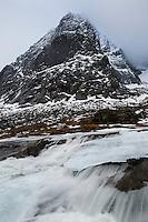 Warm temperatures melt winter snow into flowing rivers, Lofoten Islands, Norway