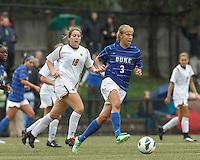 Duke University midfielder Rebecca Quinn (3) dribbles at midfield. Boston College (white) defeated Duke University (blue/white), 4-1, at Newton Campus Field, on October 6, 2013.