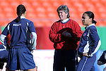 """16 October 2004: U.S. coach April Heinrichs (center) with Shannon Boxx (left) and Angela Hucles (right) before the game. The United States defeated Mexico 1-0 at Arrowhead Stadium in Kansas City, MO in an women's international friendly soccer game as part of the U.S.'s """"Fan Celebration Tour.""""."""