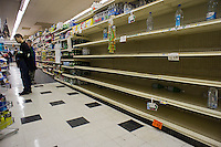 "Shelves stripped bare of bottled water by customers stocking up for Hurricane Sandy in a Gristede's supermarket in the Chelsea neighborhood of New York on Sunday, October 28, 2012. In advance of the arrival of Hurricane Sandy New York will down the subways at 7 PM on Sunday and evacuate low lying ""Zone A"" areas including Battery Park City. In addition the schools will be closed on Monday. (© Richard B. Levine)"