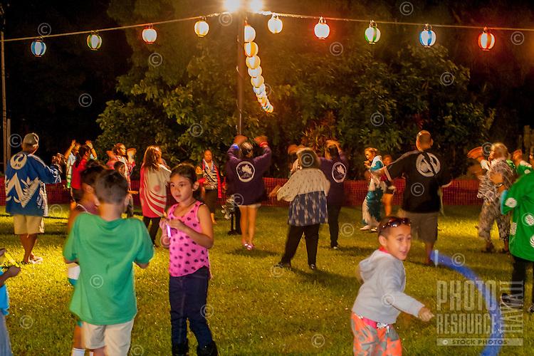 Kids play while adults dance at the Hakalau Jodo Mission Bon Dance, Big Island of Hawai'i 2014, where local families come each year to celebrate their ancestors.