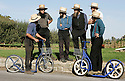 A group of local Amish men gather near the scene of a mass shooting at a one room Amish schoolhouse in Paradise, Pennsylvania Monday 02 October 2006. Police say a 32-year-old milk truck driver took about a dozen girls hostage at the school, barricaded the doors with boards and killed at least three girls and apparently himself.