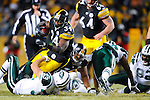 PITTSBURGH, PA - JANUARY 23: Rashard Mendenhall #34 of the Pittsburgh Steelers rushes and is tackled by Eric Smith #33 of the New York Jets in the AFC Championship Playoff Game at Heinz Field on January 23, 2011 in Pittsburgh, Pennsylvania(Photo by: Rob Tringali) *** Local Caption *** Rashard Mendenhall;Eric Smith