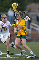 University of Vermont midfielder Adison Rounds (23) drives for the net as Boston College midfielder Mikaela Rix (17) defends. Boston College defeated University of Vermont, 15-9, at Newton Campus Field, April 4, 2012.