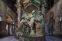 Sculptural group of the Baptism of Clovis, on the Tomb of Saint Remi, in the chancel of the Basilique Saint Remi or Abbey of St Remi, 11th century, Romanesque, Reims, France. The tomb of Archbishop Saint Remi, 440-533, who converted Clovis, the King of the Franks, to Christianity in 496 AD, is carved with Renaissance statues of the peers of France and surrounded by a 17th century enclosure. The original 16th century tomb was destroyed in the French Revolution and much of this present version dates to 1847. The abbey is a UNESCO World Heritage Site. Picture by Manuel Cohen