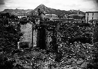 Scene of war damage in residential section of Seoul, Korea.  The capitol building can be seen in the background (right).  October 18, 1950.  Sfc. Cecil Riley. (Army)<br /> NARA FILE #:  111-SC-351356<br /> WAR &amp; CONFLICT BOOK #:  1501