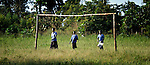 Girls walking to school in the morning in Pisak, a village in Southern Sudan. NOTE: In July 2011 Southern Sudan became the independent country of South Sudan.