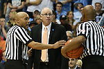 20 February 2016: Referee Bill Covington Jr. (left) steps in between Miami head coach Jim Larranaga (center) and referee Sean Hull (right). The University of North Carolina Tar Heels hosted the University of Miami Hurricanes at the Dean E. Smith Center in Chapel Hill, North Carolina in a 2015-16 NCAA Division I Men's Basketball game. UNC won the game 96-71.
