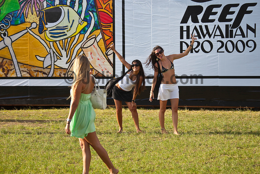 """HALEIWA, HI (Nov. 18, 2009) -- The world's first $1,000,000 surf series, the Vans Triple Crown of Surfing presented by Rockstar Energy Drink, got underway again today on Oahu's North Shore today with the battle for the record """"Triple Threat"""" prize purse. Haleiwa is playing host to the first jewel in the crown: the Reef Hawaiian Pro, a prime 6-star men's ASP World Qualifying Series event...Competition will got underway at 8 a.m. in the 3- to 5-foot surf with the completion of round two and ran 14 heats of round three...The northern hemisphere winter months on the North Shore signal a concentration of surfing activity with some of the best surfers in the wolrd taking advantage of swells originating in the stormy Northern Pacific. Notable North Shore spots include Waimea Bay, Off The Wall, Backdoor, Log Cabins, Rockpiles and Sunset Beach... Ehukai Beach is more  commonly known as Pipeline and is the most notable surfing spot on the North Shore. It is considered a prime spot for competitions due to its close proximity to the beach, giving spectators, judges, and photographers a great view...The North Shore is considered to be one the surfing world's must see locations and every December hosts three competitions, which make up the Triple Crown of Surfing. The three men's competitions are the Reef Hawaiian Pro at Haleiwa, the O'Neill World Cup of Surfing at Sunset Beach, and the Billabong Pipeline Masters. The three women's competitions are the Reef Hawaiian Pro at Haleiwa, the Gidget Pro at Sunset Beach, and the Billabong Pro on the neighboring island of Maui...Photo: Joliphotos.com"""
