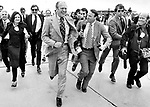 President Gerald Ford, President Gerald Ford runs from Helen Thomas question on Vietnam, Photojournalism, Photojournalist, collecting editing, presenting news photographs, President Gerald Ford, President Gerald Ford Photo by Ron Bennett,  Photojournalism, Photojournalist, collecting editing,  News, sports, features, Hollywood, White House, Political,  presenting news photographs, Photojournalism provides visual support for stories, mainly in the print media,  Commercial photography's main focus is to sell a product or service, Fine Art photography are photographs that are created to fulfill the creative vision of the photographer, record of events, published, accurate, fair representation of events, facts, relatable, relate both content and tone, photojournalist is a reporter, Fine Art Photography by Ron Bennett, Fine Art, Fine Art photography, Art Photography, Copyright RonBennettPhotography.com ©