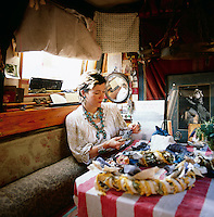 A portrait of Emma Freemantle, a fashion stylist/ artist in the dining area of her canal boat in London