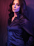 Portrait of a beautiful woman wearing a black blouse