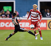 Andy Najar (14) of D.C. United tries to take the ball away from Brek Shea (20) of FC Dallas during the game at RFK Stadium in Washington, DC.  D.C. United tied FC Dallas, 0-0.