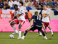 Tony Tchani, Adel Taarabt. Tottenham defeated the New York Red Bulls, 2-1.