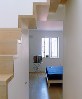 Designed in a simple contemporary style the open staircase of this apartment makes an interesting sculptural statement