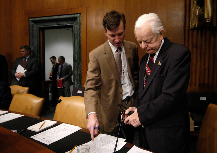 Sen. Robert Byrd, D-WV. speaks to an aide before an Senate Armed Services Committee Defense Authorization hearing on the FY2007 Defense Department budget and the Future Years Defense Program..