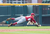 Rhode Island vs Arkansas Razorbacks Men's Baseball – Carson Shaddy of Arkansas makes a diving stop against Rhode Island at Baum Stadium, Fayetteville, AR, Sunday, March 12, 2017.  © 2017 David Beach