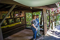 Tourists under the shelter of a covered photo exhibit at the Hawai'i Tropical Botanical Garden, Onomea, Big Island of Hawaiʻi.