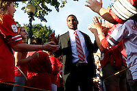 Ohio State Buckeyes quarterback Braxton Miller (5) high fives fans as the team makes their way into the stadium before the NCAA football game between the Ohio State Buckeyes and the Wisconsin Badgers at Ohio Stadium in Columbus, Saturday evening, September 28, 2013. (Columbus Dispatch  / Eamon Queeney)