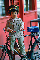 Boy on a bike wearing uniform in Beijing, China