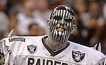 Silver and black stripes are in fashion on Saturday, August 24, 2002, in Oakland, California. The Raiders defeated the 49ers 17-10 in a preseason game.