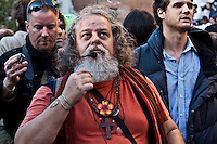 Protester - 2011<br /> <br /> London, 15/10/2011. St Paul's Square became the stage of the UK arm of the &quot;Occupy&quot; protest movement which has been growing around the world. The Occupy movement is a world-wide protest against the financial crises created by the actual financial system, by speculation, by deregulation, and by the actions of major international financial and investment banks. Around 2,000 protesters armed with tents and placards, gathered outside the famous Cathedral intending to occupy Paternoster Square, home of the London Stock Exchange and the heart of the City of London, but they were hampered by City police officers. After this failed attempt the protesters decided to camp in front St Paul's where the situation with police forces became immediately tense. Masked like the character of Guy Fawkes from the movie &quot;V for Vendetta&quot;, Julian Assange appeared on the square to give a speech in support of the protesters. During the late evening police forces heavily armed with riot control equipment charged the square, attempting to evict the occupants who resisted. Later in the evening the police retreated and the occupation continued peacefully.