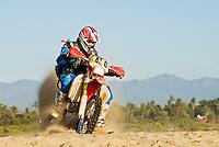 Male dirt bike rider along beach in Baja Mexico