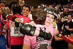 The Hellcats and Putas del Fuego congratulate each other after their bout at Palmer Events Center in Austin, Texas.