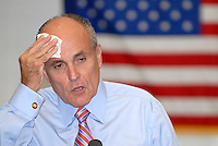 ATLANTA, GA - May 16, 2008: Former New York City Mayor and Republican Presidential candidate Rudy Giluliani wipes his brow during a question and answer period of at a town hall meeting at the Emerson Student Center's Talmage Room at Olgethorpe University in Atlanta, Georgia.