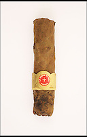 BNPS.co.uk (01202 558833)<br /> Pic: PFCAuctions/BNPS<br /> <br /> ***Please Use Full Byline***<br /> <br /> Sir Winston Churchill's partly smoked cigar. <br /> <br /> A CIGAR half-smoked by Winston Churchill during a Cold War meeting with world leaders is going up for sale.<br /> <br /> A soldier guarding the room of Churchill, US President Dwight Eisenhower and French Premier Joseph Laniel at the three-power conference held in Bermuda in 1953 collected the still-smoking cigar when he was sent in with others to tidy up after the meeting had ended.<br /> <br /> The La Aroma de Cuba cigar, which Churchill was known to smoke alongside his more famous Romeo y Julieta brand, is about three-and-a-half inches long.<br /> <br /> The cigar is sold with a letter of provenance from the soldier, Rudolph Hughes, who was serving with 1st Battalion Royal Welch Fusiliers in Jamaica when he got sent to Hamilton, Bermuda to guard some of the world's most important men of the time.<br /> <br /> Acting Provo Sgt Hughes guarded the main conference room for several hours, armed with a machine gun, alongside two FBI men.<br /> <br /> As well as the letter of provenance, the cigar also comes with various Bermudian press cuttings and Hughes' Bermudian driving licence.<br /> <br /> The auction is being held by PFC Auctions and bidding is open until 7pm on October 1. The opening bid is &pound;240 but it is expected to sell for &pound;2,000 to &pound;3,000.