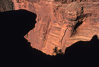 """Reminiscent of New Hampshire's """"Old Man of the Mountain,"""" a profile of stone is silhouetted against the vermilion walls of Canyonlands National Park, Utah, along the Lathrop Trail."""