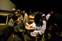 Dabboussiyeh border, July 14, 2006.One of 2 border passages still open between Syria and Lebanon under attack. Thousands of people try to cross the border to Syria amidst undescriptible chaos, Syrian workers, Lebanese families and foreign tourists trying to escape the looming war.