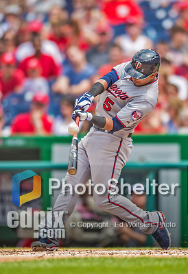 9 June 2013: Minnesota Twins infielder Eduardo Escobar connects during a game against the Washington Nationals at Nationals Park in Washington, DC. The Nationals shut out the Twins 7-0 in the first game of their day/night double-header. Mandatory Credit: Ed Wolfstein Photo *** RAW (NEF) Image File Available ***