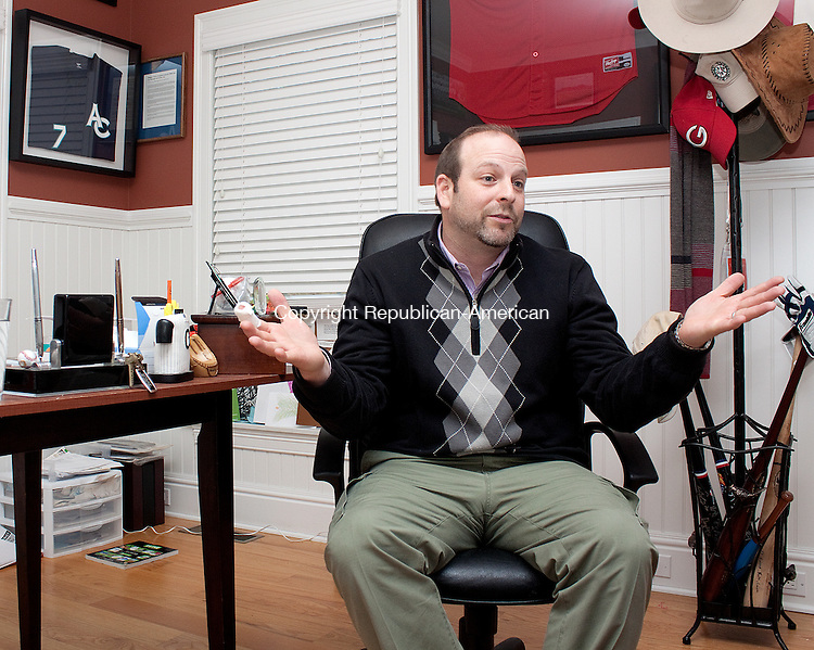 SOUTHBURY CT.-15 DECEMBER 2011 1121511DA01- The new owner of the Titans, Torrington's collegiate baseball team, Chris Carminucci of Southbury talks about the future of the team inside his home on Thursday.<br /> Darlene Douty Republican American.