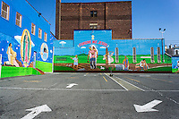 Religious mural outside a community organization in the Bushwick neighborhood of Brooklyn in New York on Saturday, April 27, 2013. The neighborhood is undergoing gentrification changing from a rough and tumble mix of Hispanic and industrial to a haven for hipsters, forcing many of the long-time residents out because of rising rents.. (©Richard B. Levine)