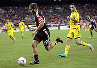 WASHINGTON, DC - OCTOBER 20, 2012:  Chris Kolb (22) of D.C United gets away from Justin Meram (9) of the Columbus Crew during an MLS match at RFK Stadium in Washington D.C. on October 20. D.C United won 3-2.