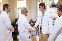 From left, Stephen Leffler, M.D., Dean Rick Morin, M.D., Brian Till, Christa Zehle, M.D. Class of 2017 White Coat Ceremony.