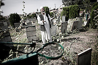 A Kashmiri man bawls bereaved in front of his son's grave as he cries out woeful at Iddgah Martyr's graveyard in Srinagar. This is the biggest Martyr's graveyard of Muslim rebels and civilians killed by Indian forces during the last 20 years of conflict. Hundreds of graveyards like this exist throughout Kashmir. Srinagar, Indian administrated Kashmir.
