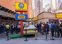 """Fans line up at a pop-up of the renowned Los Polos Hermanos chicken fast food restaurant appearing in a parking lot in Lower Manhattan in New York on Sunday, April 9, 2017. The fictional restaurant is part of the plot of """"Better Call Saul"""" (and its parent program """"Breaking Bad"""") on the AMC network. Serving free curly fries to its fans who waited several hours to get in, the two-day branding event's last day is Monday, April 10, 2017. """"Better Call Saul"""" debuts its new season on April 10. (© Richard B. Levine)"""