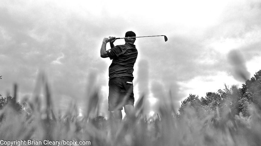 Golfer hits an approach shot with a 3 iron, Bowmanville Golf and Country Club, Bowmanville, Ontario, Canada, (Photo by Brian Cleary/www.bcpix.com)