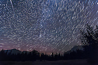 Two bright Perseid meteors streaka cross the rising star trails of the autumn constellations. This is a stack of 9 x 1 minute exposures, taken sequentially, with the Canon 5D MkII at ISO 3200, and 16-35mm lens at f/6 and 17mm. Taken at the Upper Bankhead parking lot, Banff, Alberta during the peak night of the 2012 Perseid meteor shower.